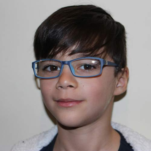 Child wearing eye glasses frame from J & J Optical