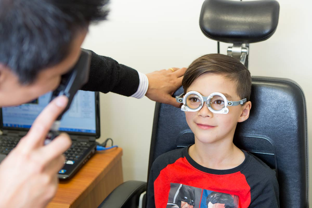 Jason performing retinoscopy during eye test